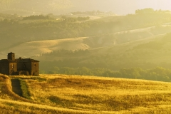 Umbria, Italy - An old ruined country house on the top of the hill in a sunny morning.
